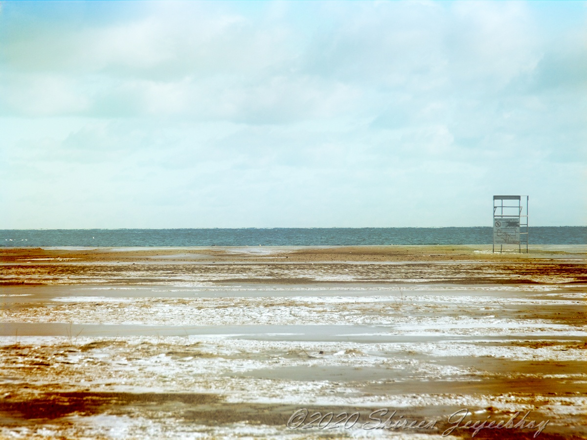 Woodbine Beach Desolate with Lifeguard Chair Empty in Winter, and with Special Effects